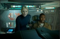 Charlize Theron and Idris Elba on the bridge of the ship Prometheus.